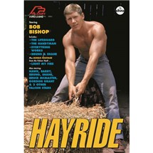 Blonde male shirtless lifting hay bail