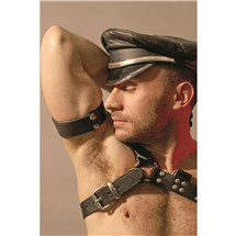 Topless male in leather cap